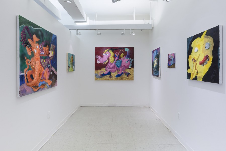View of multiple paintings hung at the studio of Nicasio Fernandez