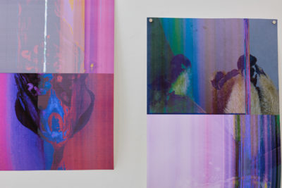 A close up of two abstract photographs printed in rich purples and violet colors