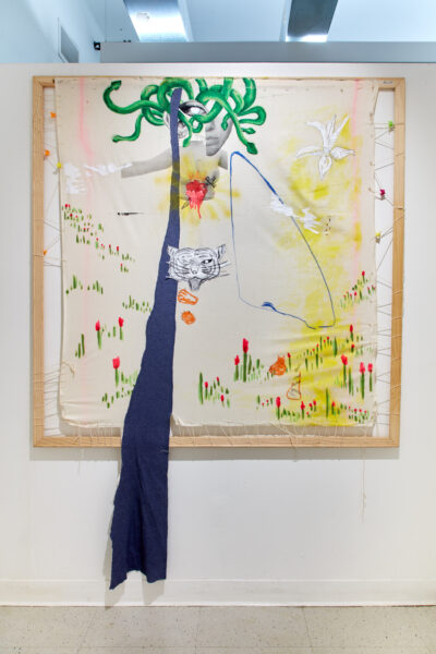 Canvas stretched onto bars by string, representations of a woman, open arms, sacred hear, and medusa head holding a white lily with a tiger below her torso.