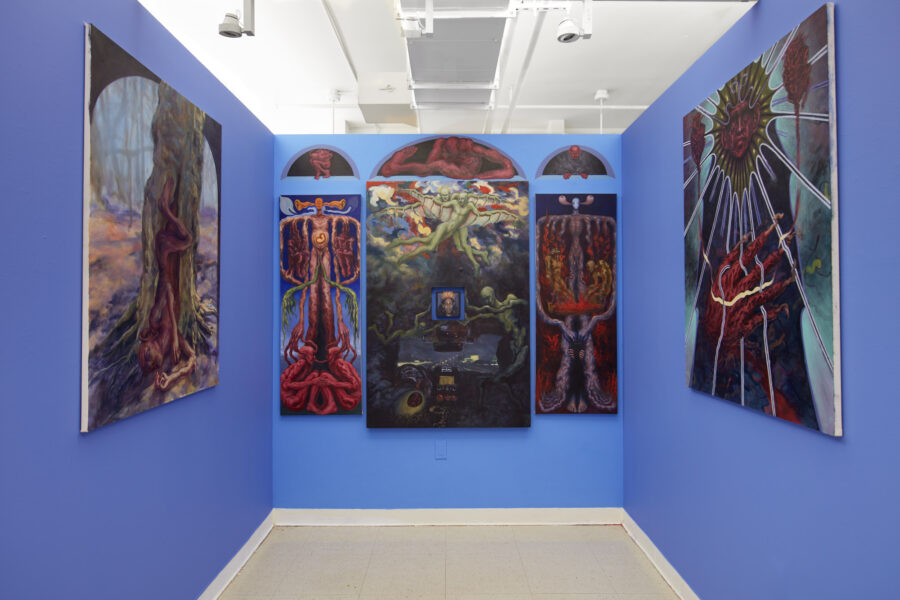 Six oil paintings of various dimensions hang in bilateral symmetry on 3 blue walls.