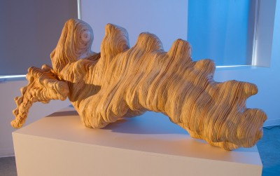 A wooden sculpture created using the Shopbot CNC milling machine. A student carved several layers of the 3D model from sheets of plywood.