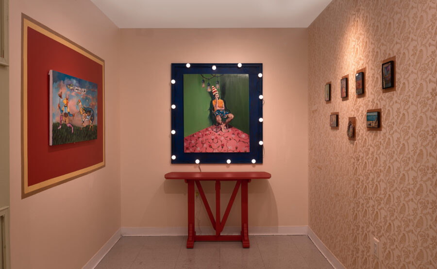 An installation shot of three walls with artworks hanging of The Dunce, Untitled, The Miniatures