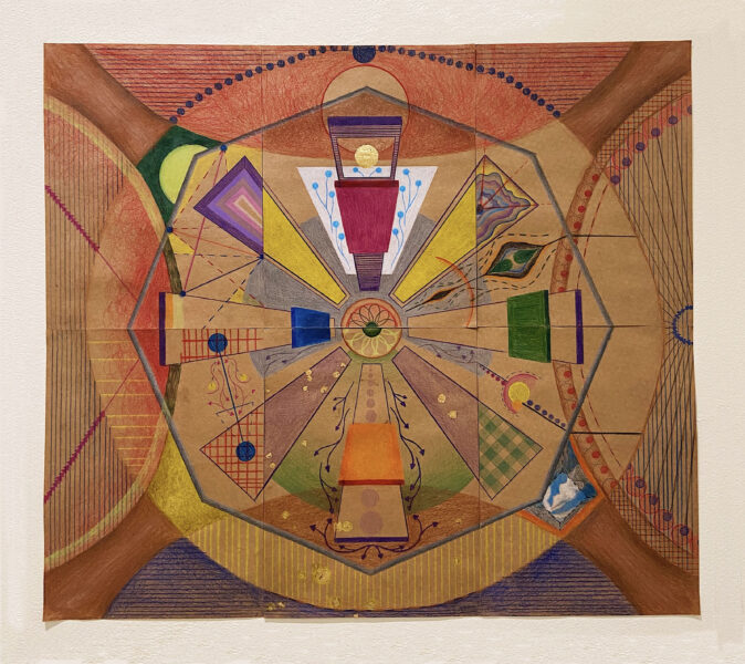Srishti Dass, Mannat, 2021. Colored pencil and gold leaf on paper. 24 x 27 inches. Six 9x12-inch brown paper sheets combined to make a horizontal composition. with a circle in the middle and eight protruding trapezoids to form a bigger circle. Each section of a trapezoid has a different pattern. Some patterns are organic and flowing and others are geometric with hard edges. All these shapes are encapsulated in a grey hexagon. There are four brown pillar-like structures on each corner of the drawing. These pillars create a semi-circle negative space on each edge of the drawing. Each of these semi-circles has a different geometric pattern. There is a gold leaf circle at the top center of the composition and some smaller ones at the bottom center creating a confetti effect.