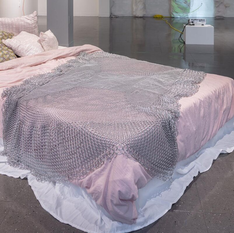 Emma Fasciolo: Chainmail Blanket, 2019. Aluminum on bed. 40 x 60 inches.