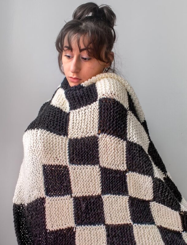 Emma Fasciolo: Checkered Blanket, 2020. Knit yarn.