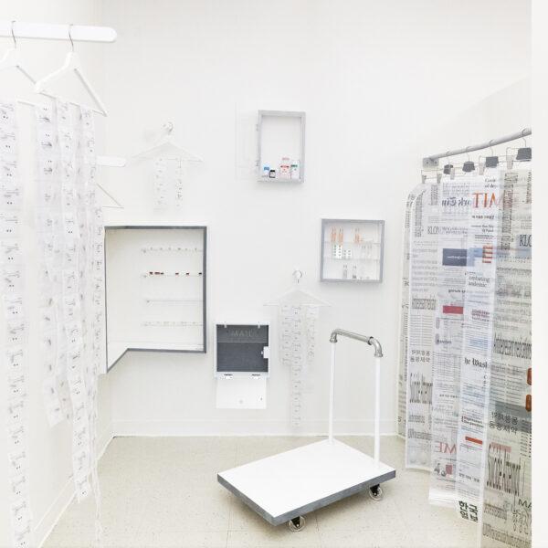 Antonia-Marie Kim, Untitled, 2020. Prescription pills, bottles, fabric, vellum, paper, coat hangers, acrylic plexiglass, and wood. Dimensions variable. Installation view.