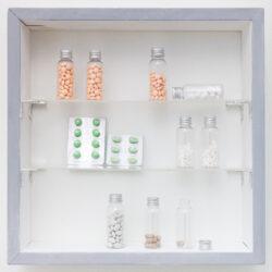 Jihyun (Antonia) Kim, Untitled, 2020. Prescription pills, bottles, fabric, vellum, paper, coat hangers, acrylic plexiglass, and wood. Dimensions variable. Detail.