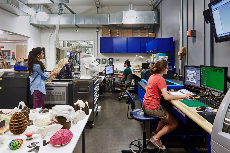 An interior view of the Digital Sculpture Lab showing students and staff working together.