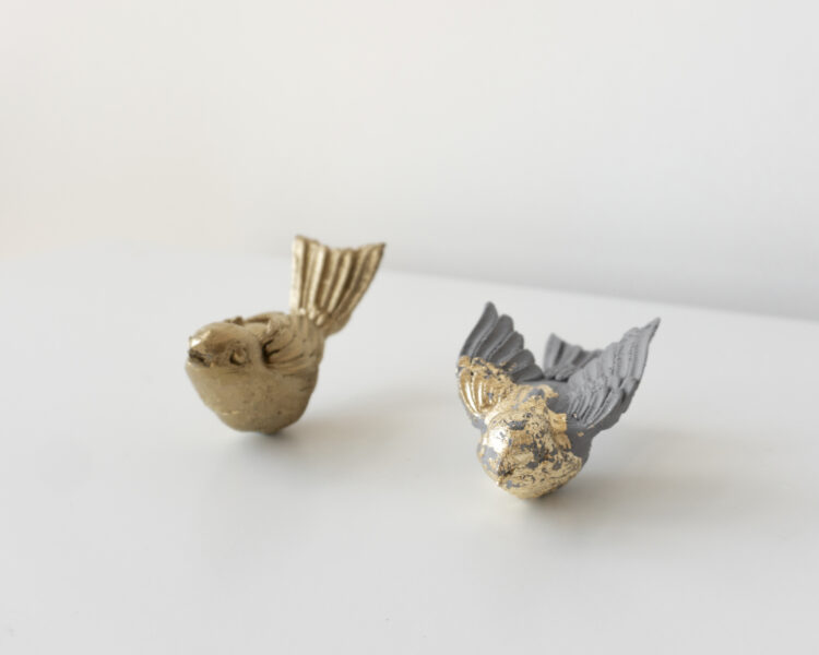 Lanyi Gao, Take Off, 2020. Gold foil on PLA. Each piece measures 1.5 x 1.5 x 4 inches.