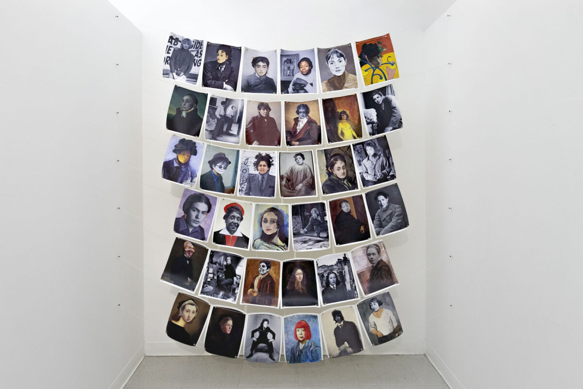 Images of male artists printed on canvas. Their faces are being covered by female artists' faces, print on canvas. These images are connected and hanging by the use of grommets and twine. There are six individual images going across horizontally and down vertically, each image is 8.5 inches by 11 inches. The entire digital collage as a whole is 80 inches by 85 inches.