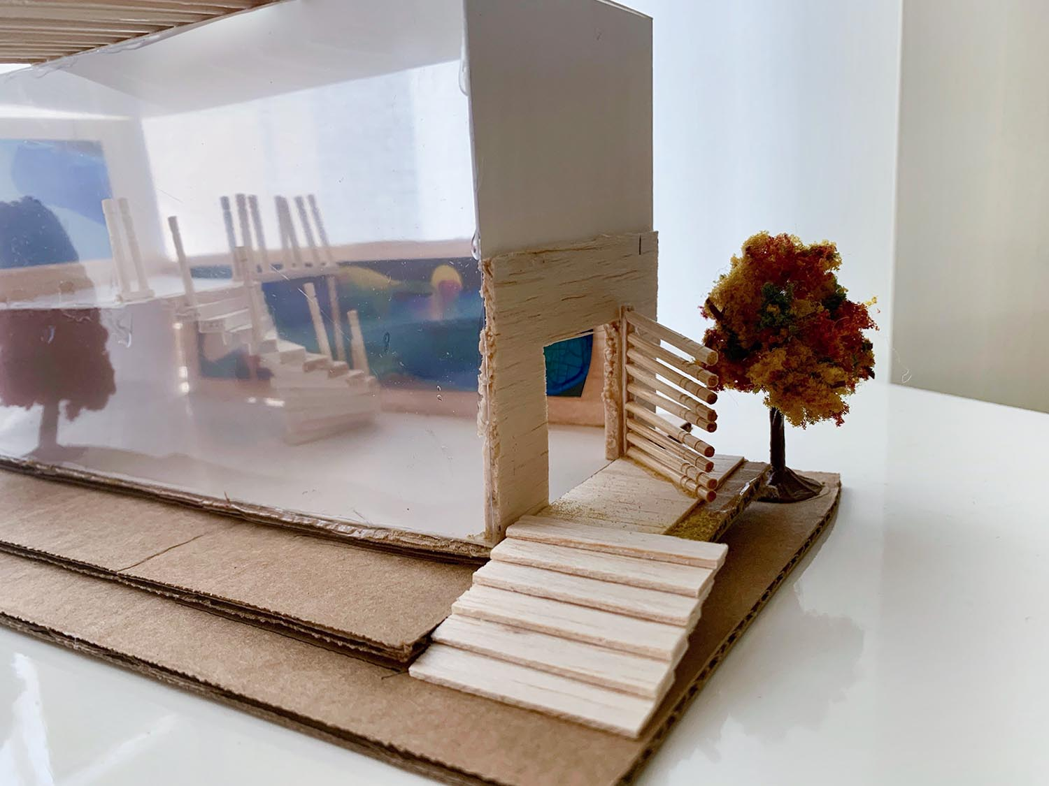 Jessica Simonis: Home #1, 2020, Balsa Wood, Cardboard, Canvas, Clay, Acetate Sheets, 20x13 inches.