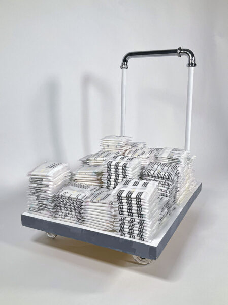 Front view of a mover's cart with sanitary napkins stacked on top