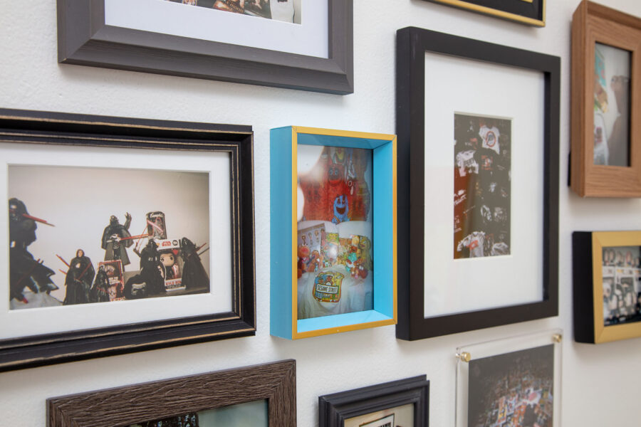 10 framed images of different collections photographed from a tight left angle. There are images of collections of Star Wars, Kylo Ren, Twilight, Andy Warhol, My Chemical Romance shirts and action figures, Doom Patrol comics, ET, Sesame Street, and Phantom of the Paradise. All images are four by 6 inches photographed on a disposable 35 millimeter film camera.