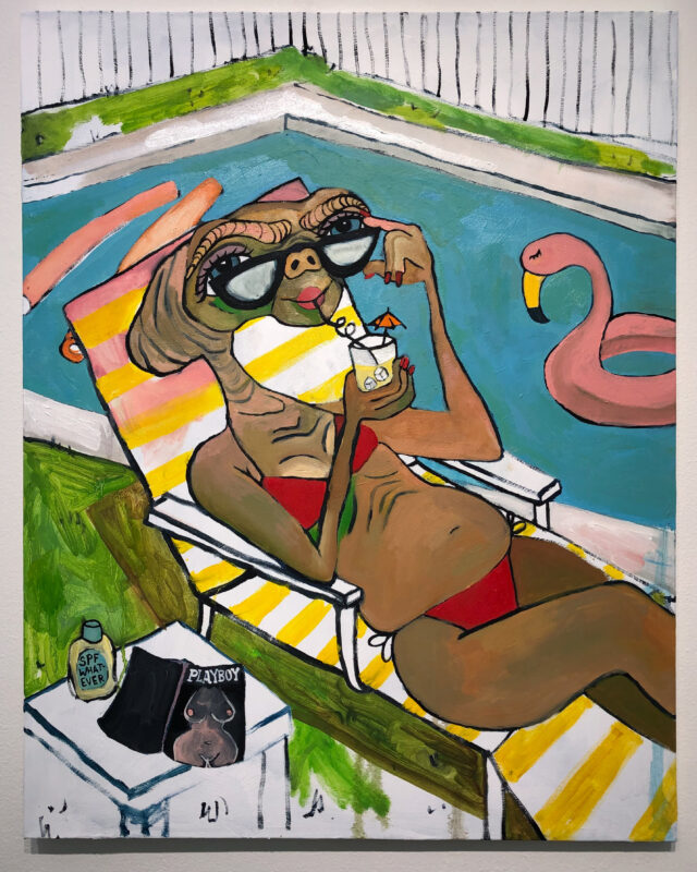 """ET, the character from the 1982 film, is crudely painted in a red bikini on a yellow and white striped lawn chair. They are looking over a pair of sunglasses and drinking out of a glass with an umbrella. Next to them is a small table, on it, a copy of Playboy magazine and sunblock labelled """"SPF whatever"""". There is a fence and a pool with pool noodles and a flamingo floatie in the background."""