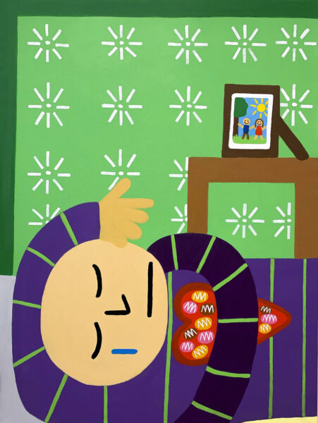 A light skin toned bald boy crying in bed with a blue tear down his face holding a heart box filled with chocolate. The background is filled with white flowers and a side with a picture of a couple framed outside.