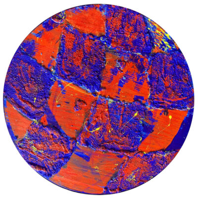 A painting by Ryan Cosbert. The painting is set on a circular wooden panel with acrylic paint in bright orange and blue colors with swirls of yellow paint across the surface.