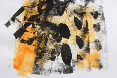 An abstract mono print using orange and blank paint.