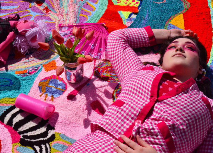 Colorful Tufted rug with girl laying on her back