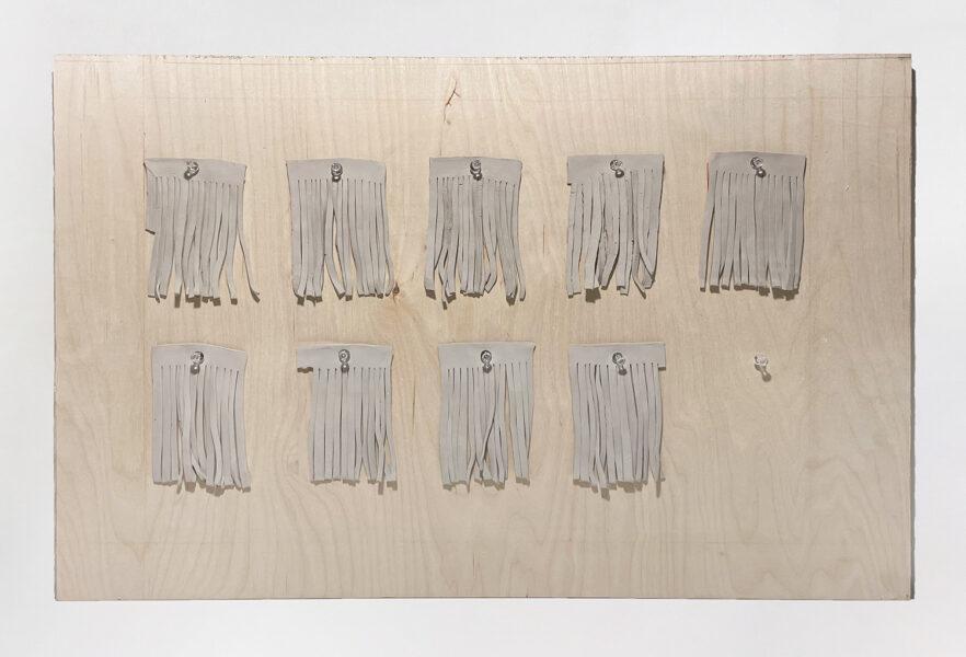 Yilin Sun, Cutters, 2020. Ceramic, plastic pins, and plywood. Ceramic pieces 4 x 3 inches and plywood 30 x 20 inches. 30 x 20 inch board.