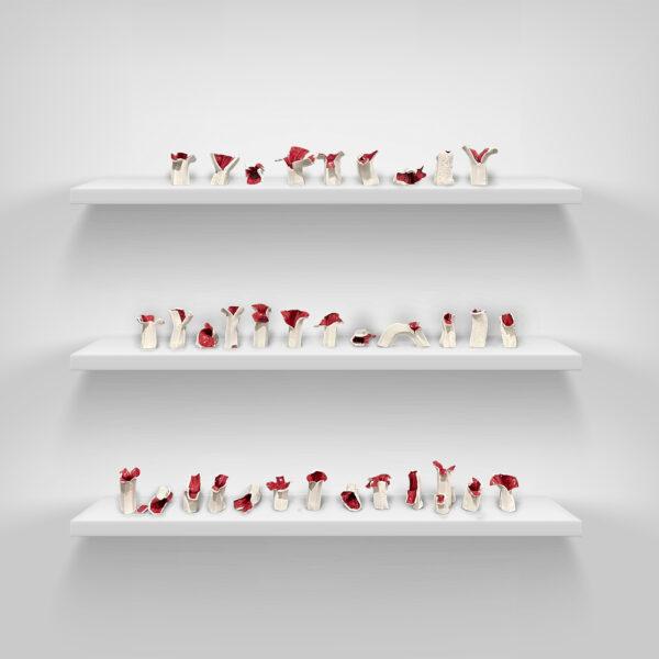 Yilin Sun, <i>Flower Sacrifice</i>, 2020. Ceramic and red glaze on interior. Each 6 inches tall.