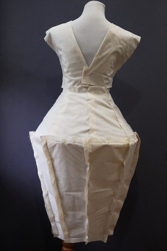 Tiffany Bales: Untitled (in progress), 2020. Unbleached muslin fabric, sand, mold builder, thread, chicken wire.
