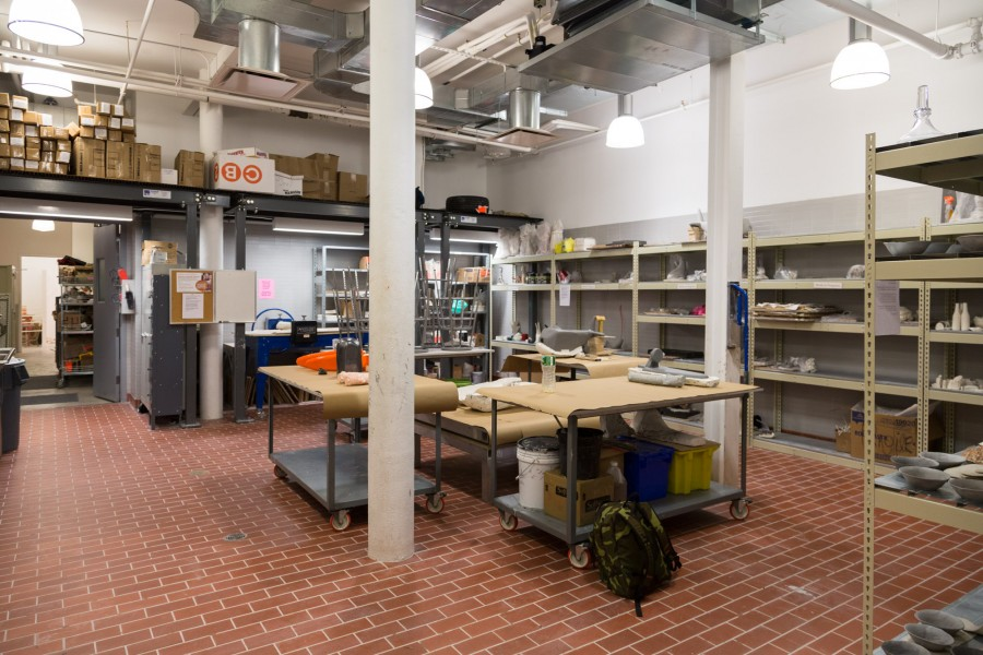 The ceramics workshop with large tables and shelves.