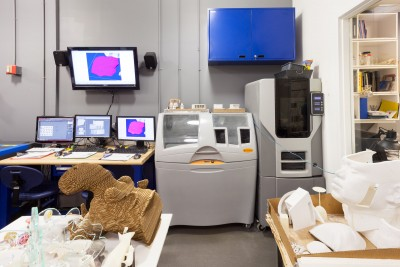 An interior view of the CNC Digital Sculpture lab. In the foreground are various works by students in Digital Sculpture. Also visible are two rapid-prototyping machines.