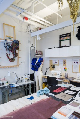 Various student embroidery projects arranged on a table in the Fibers Lab, BFA Fine Arts | SVA