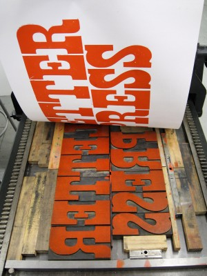 Pulling off a letterpress print. The word