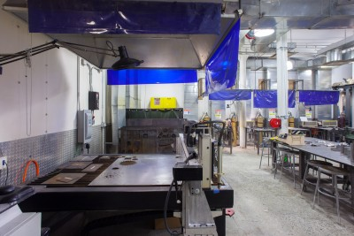 CNC Plasma cutter on front. Safety equipments on the right. Sheet Metal materials and MIG welding station on the back.