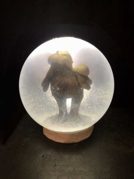 """large snow globe 12"""" 33lbs on steel stand dramatically lit the relic 2 is a Pillsbury dough boy also with no head"""