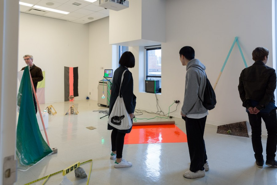 Students visit an installation with artworks by Sofia Abraham during Open Studios.